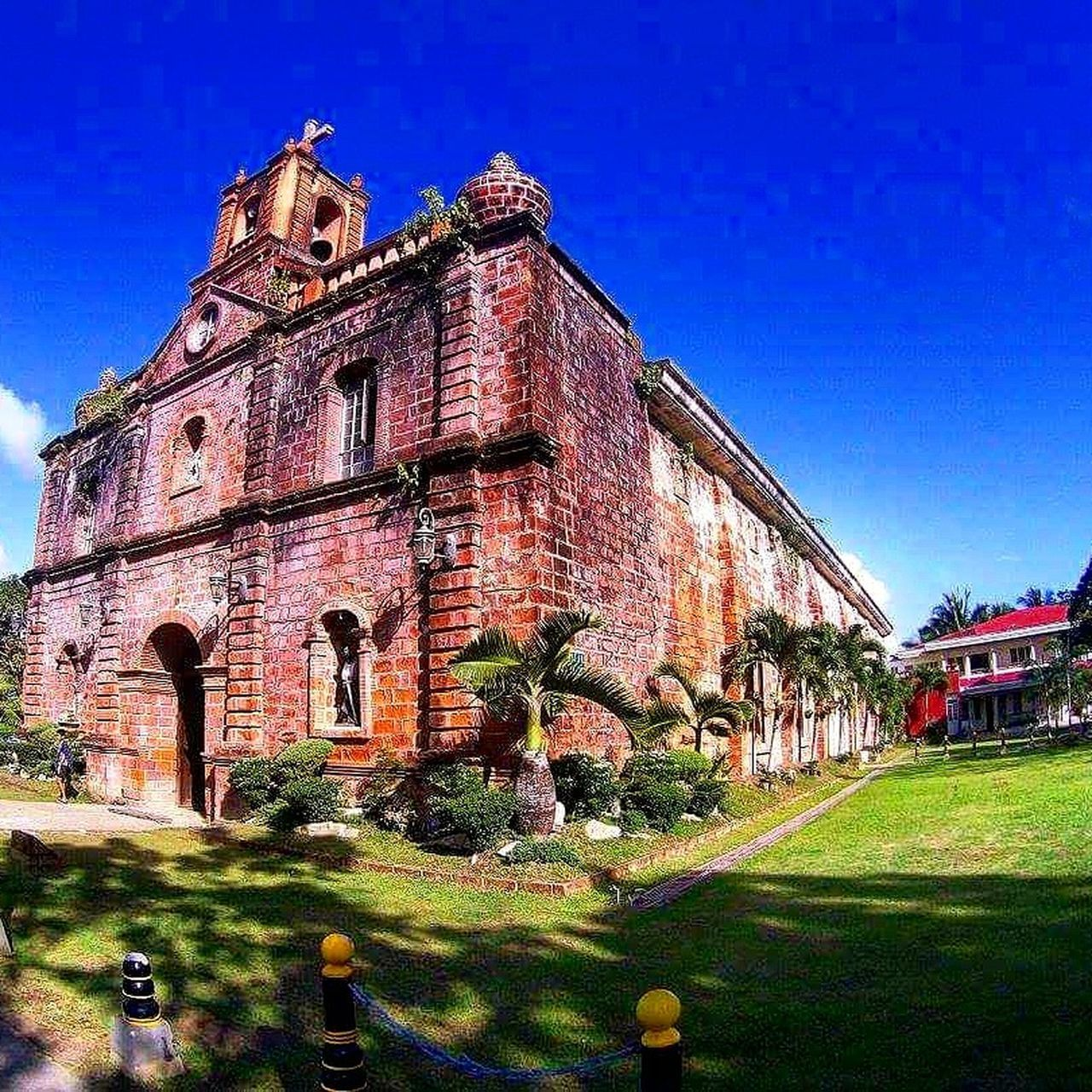 The red Church of Caramoan, CamSur, Philippines, Stmichaelthearchangel Building Exterior History 16thcentury Church Redbricks Redbrickschurch Byahenitinoki Caramoan Camsur Bicol Travelph TravelPhilippines Grass Outdoors