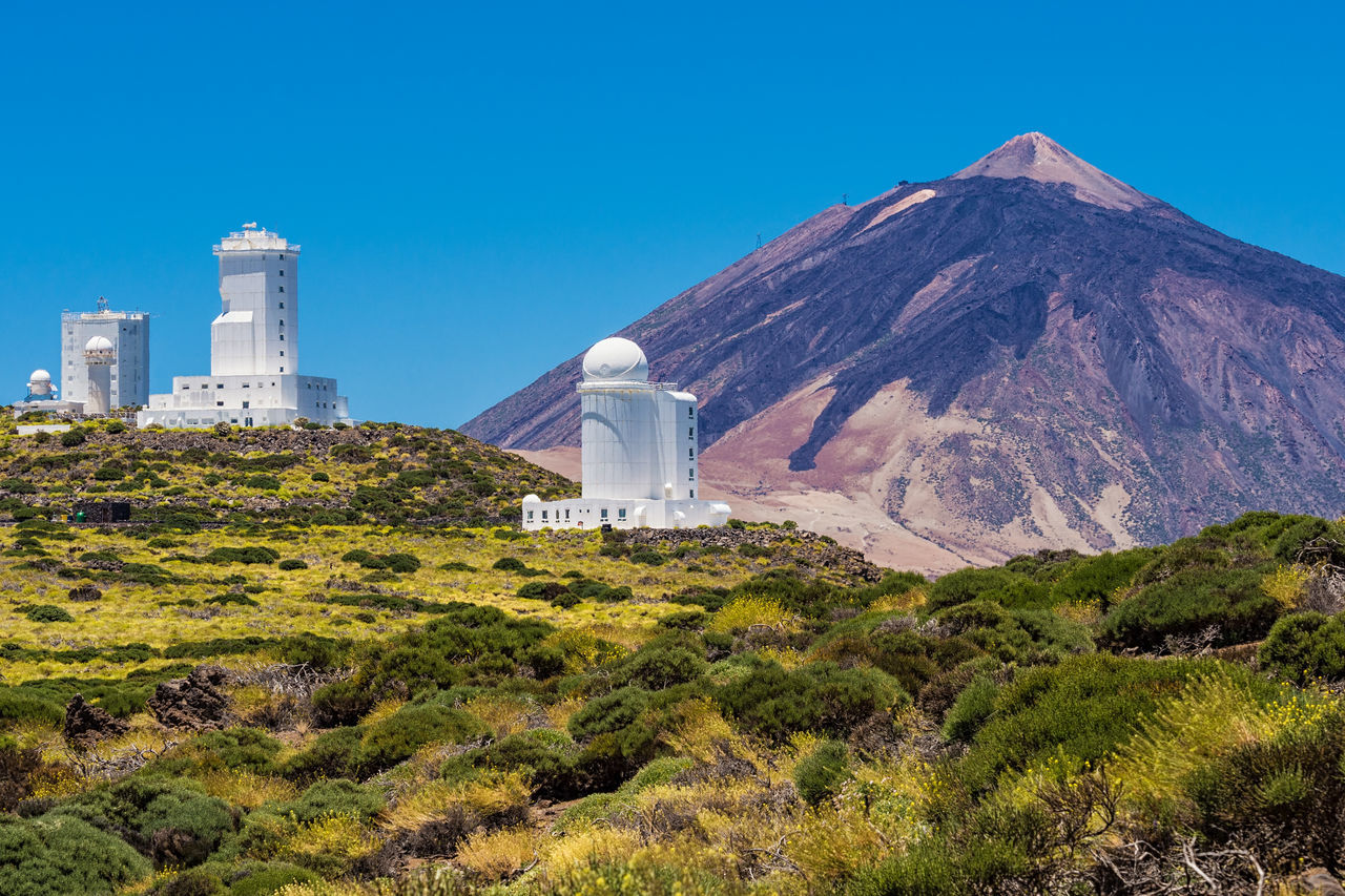 The Observatorio del Teide on the island Tenerife, Spain. Architecture Building Exterior Bushes Canary Islands Clear Sky Holiday Landmark Mountain No People Observatorio Del Teide Observatory Outdoors Plants Shrubs Sky SPAIN Tenerife Island Tourism Travel Vacations Volcano