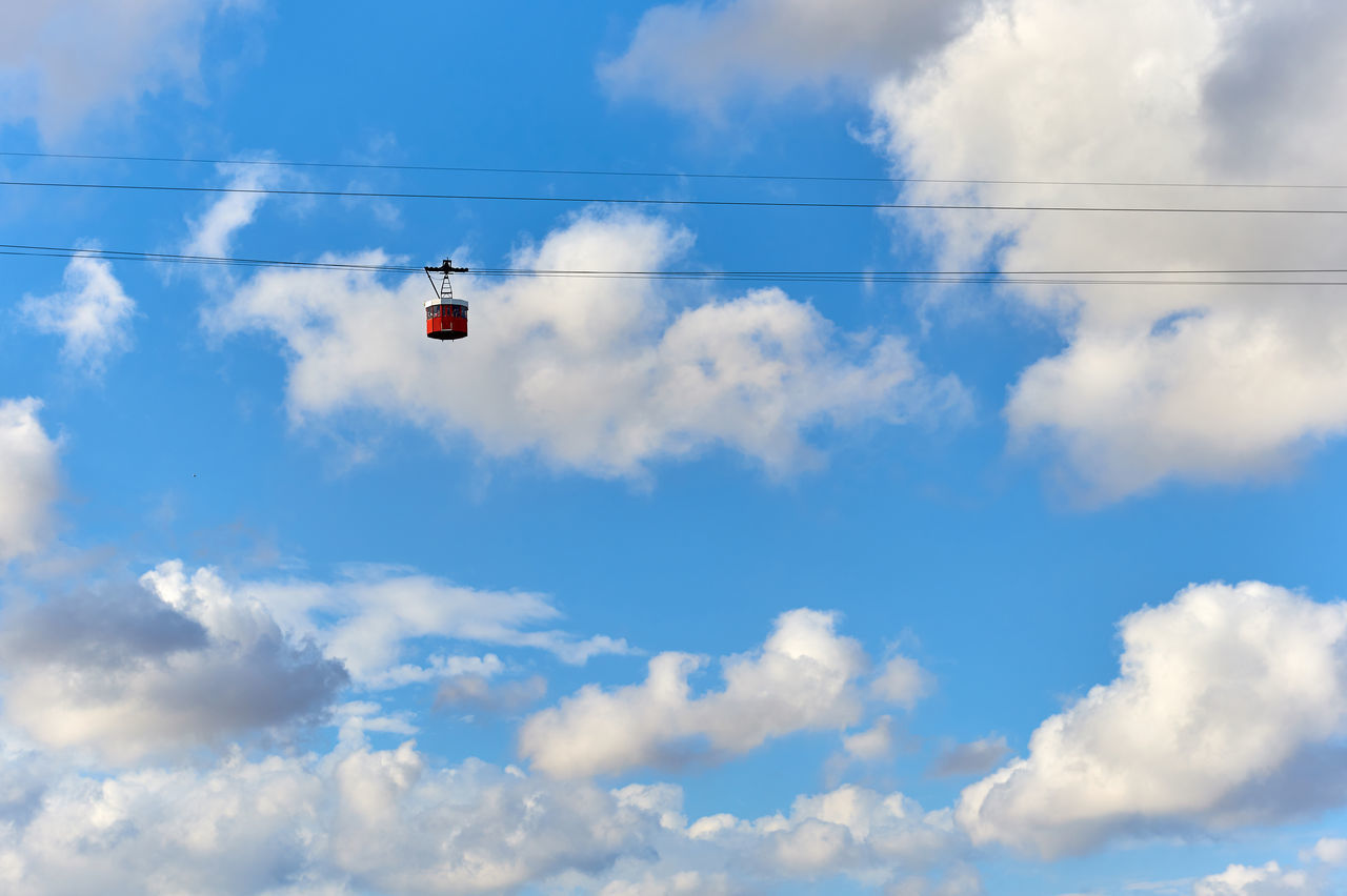 Cable car against blue cloudy sky. Barcelona. Spain Adventure Altitude Barcelona, Spain Blue Cable Car Cableway Cloudy Day Elevated Road Europe Funicular Funicular Cabin Funicular Railway Gondola Landscape Nature Outdoors Overlook Sky SPAIN Sunny Day Tourist Attraction  Transport Transportation Travel