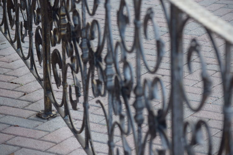 Close-up Day Iron - Metal Ironwork  Metal No People Outdoors Shadow Sunlight Wrought Iron Wrought Iron Design Wrought Iron Fencing