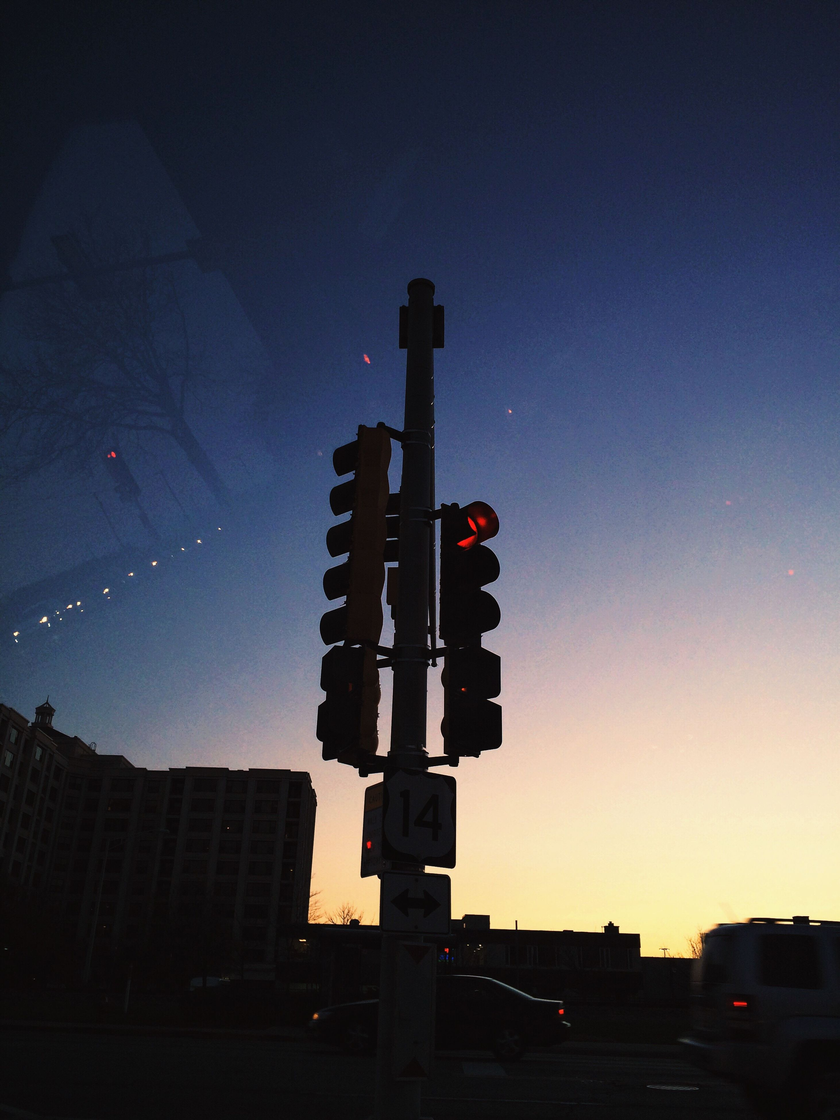 clear sky, night, building exterior, illuminated, low angle view, built structure, silhouette, architecture, transportation, copy space, city, sky, dusk, car, land vehicle, street light, mode of transport, outdoors, sunset, blue