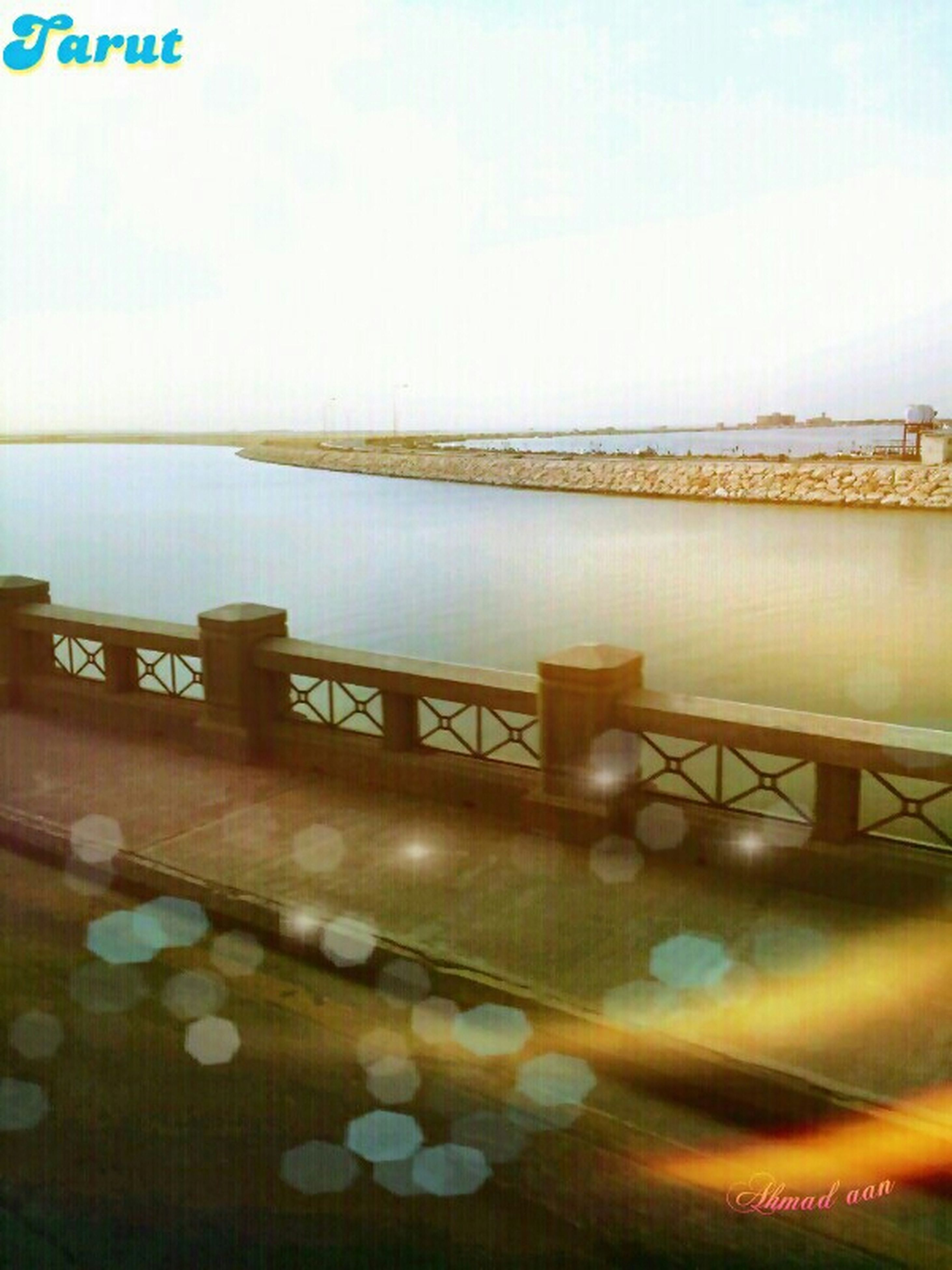 water, built structure, architecture, sky, sea, railing, river, bridge - man made structure, nature, connection, tranquility, scenics, tranquil scene, outdoors, no people, transportation, copy space, beauty in nature, building exterior, high angle view