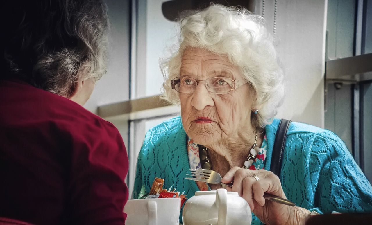 - LADY AYLESWORTH IS NOT AMUSED TODAY - Lady Showcase June Teatime Tea Time Ladys Listening Annoyed Resentful Eating Fork Indoors  Old Lady Ladies Talking Storytelling Lunch Lunchtime Sunny People Sitting People Photography Streetphotography Street Photography Check This Out Light And Reflection