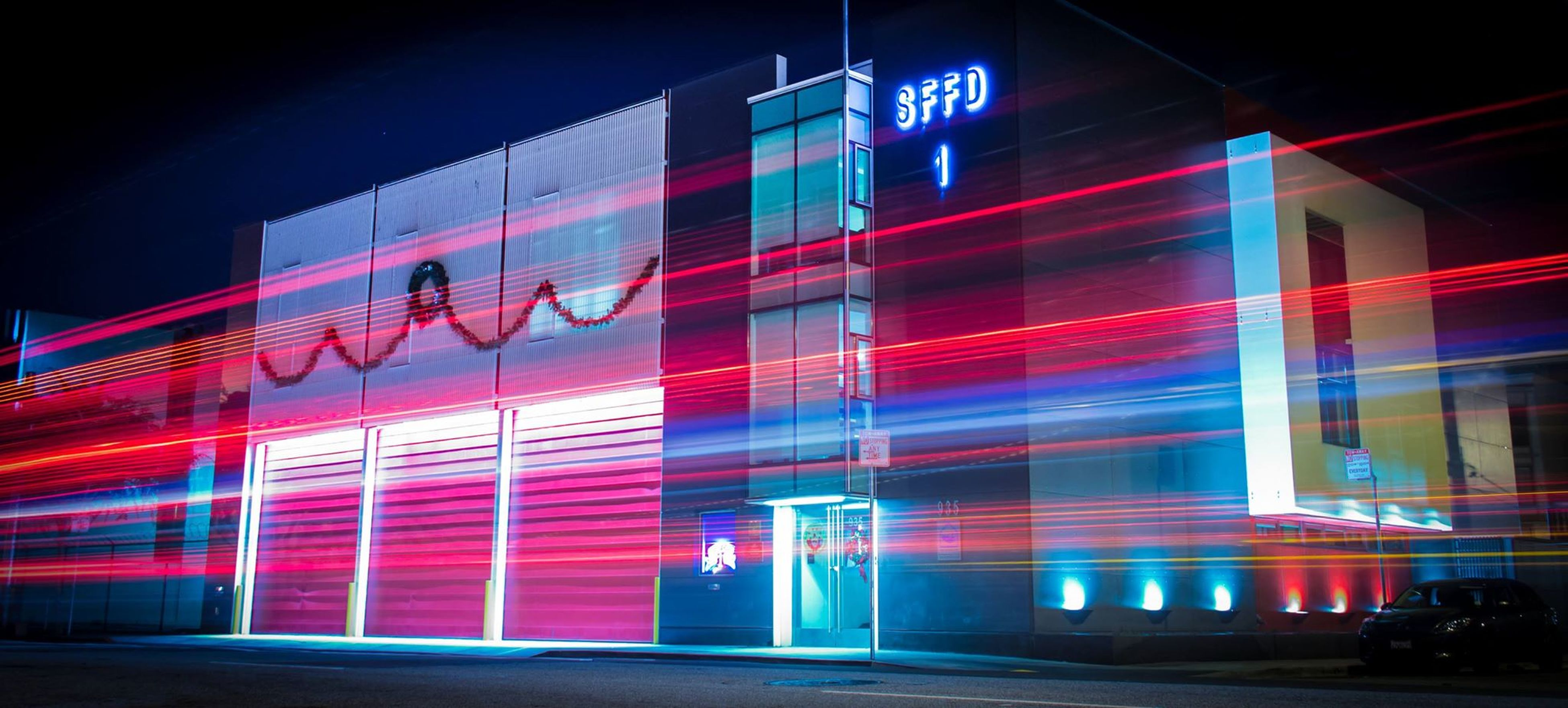 illuminated, text, night, western script, built structure, architecture, multi colored, communication, building exterior, advertisement, city, graffiti, neon, transportation, modern, commercial sign, non-western script, blue, long exposure, sign