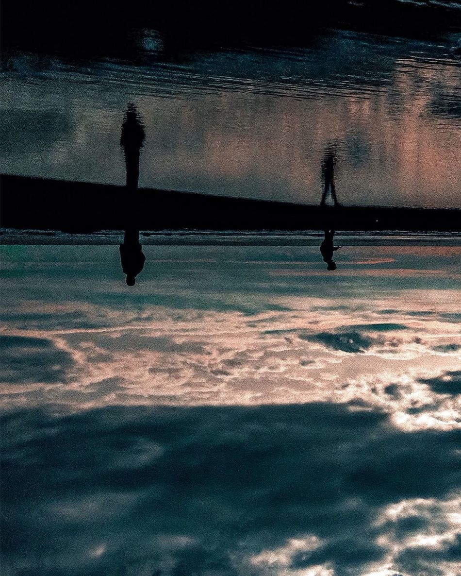 Reflection is a powerful tool to make you wonder about anything. Water Silhouette Reflection Waterfront Nature Sea Outdoors Two People Sky Sunset Real People Men Beach Beauty In Nature Day