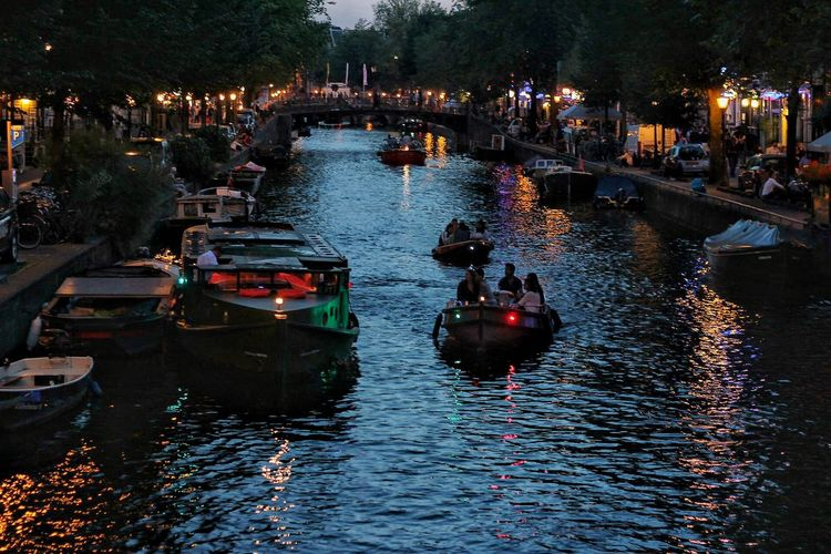 Amsterdam Boat Canal City Life Group Of People High Angle View Illuminated Mode Of Transport Nature Nautical Vessel Reflection Sea Tranquility Transportation Water Waterfront First Eyeem Photo