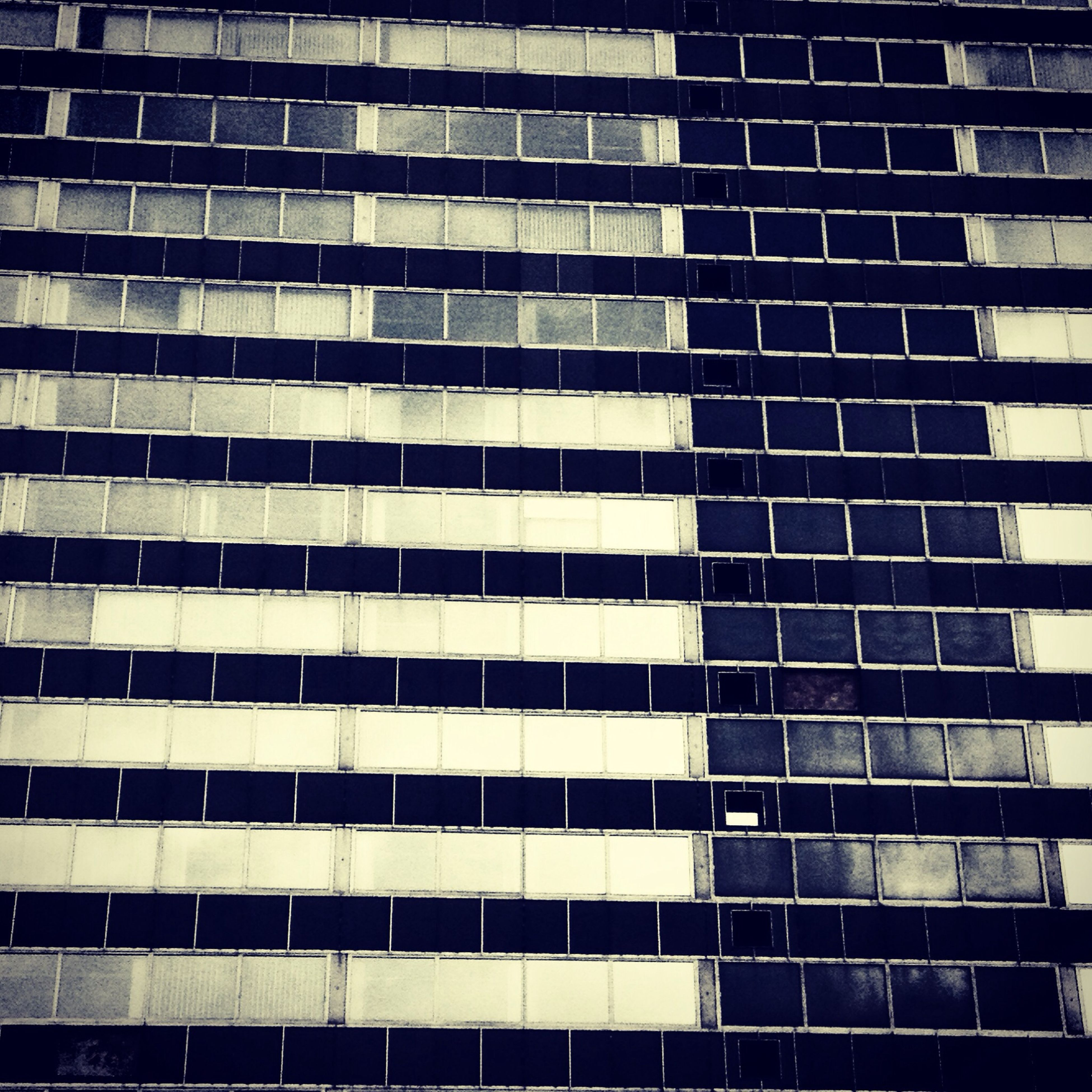 building exterior, architecture, built structure, modern, city, office building, skyscraper, building, low angle view, tall - high, window, glass - material, tower, reflection, city life, day, outdoors, repetition, full frame, pattern