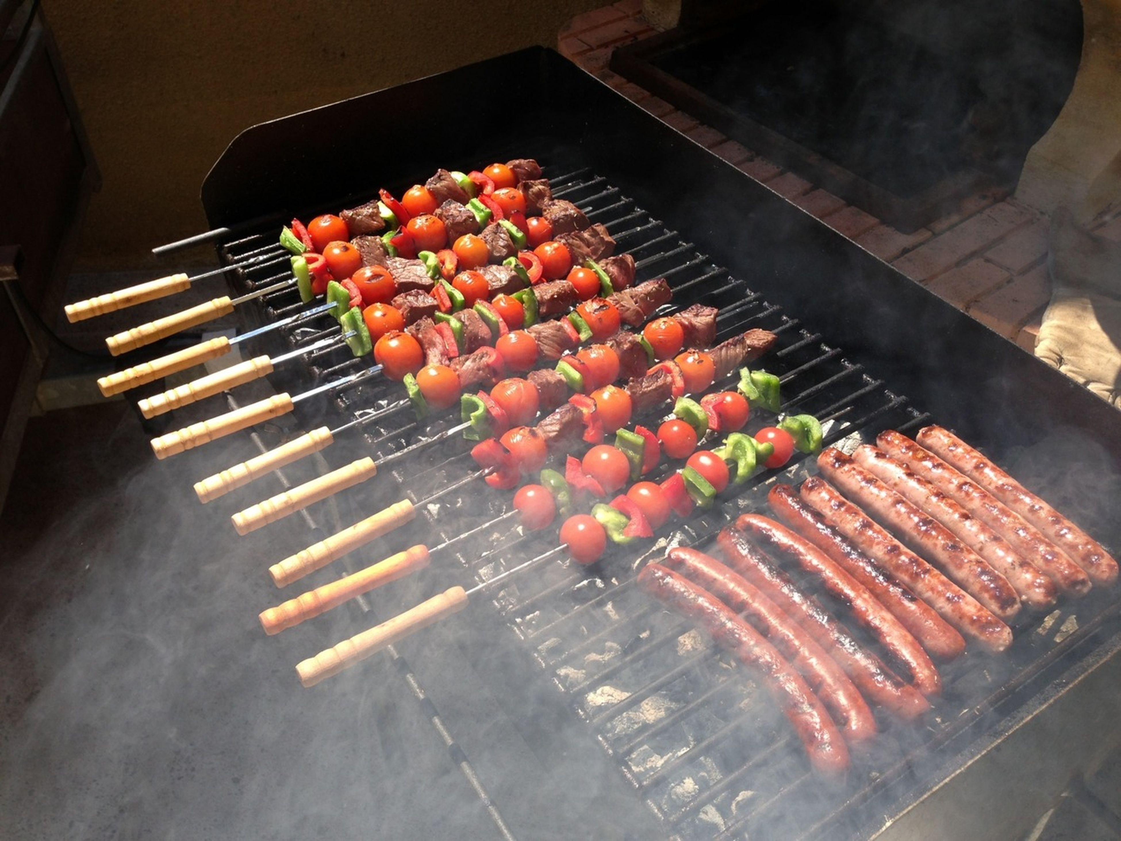 food, food and drink, indoors, high angle view, freshness, large group of objects, preparation, barbecue grill, abundance, heat - temperature, barbecue, arrangement, preparing food, healthy eating, cooking, still life, in a row, meat, for sale, stack