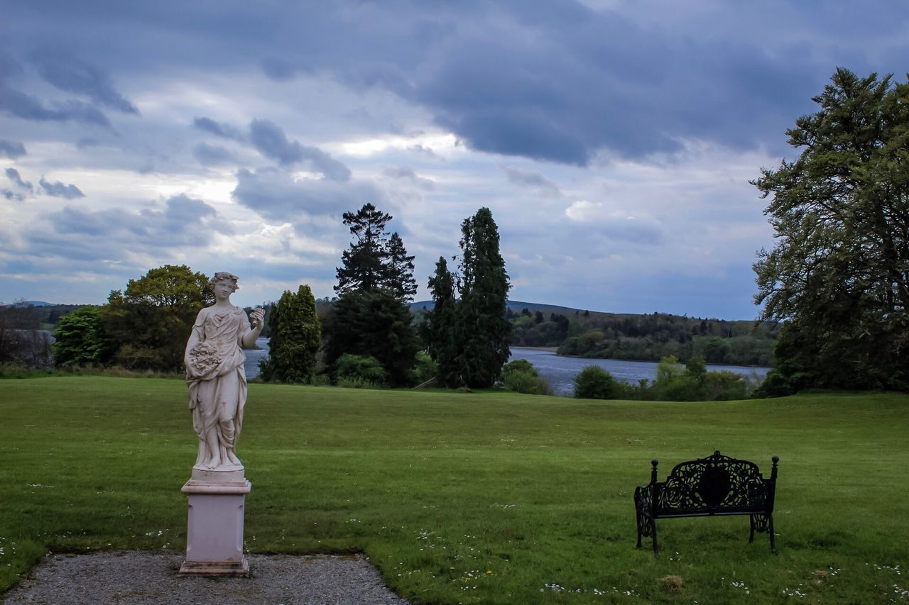 Kilronan Castle, Co Roscommon, Ireland, Statue in the grounds, Sky Cloud - Sky Human Representation Statue Tree Grass Sculpture Nature Field Landscape Beauty In Nature Tranquil Scene Growth Tranquility Park - Man Made Space No People Day Outdoors Scenics The Great Outdoors - 2017 EyeEm Awards