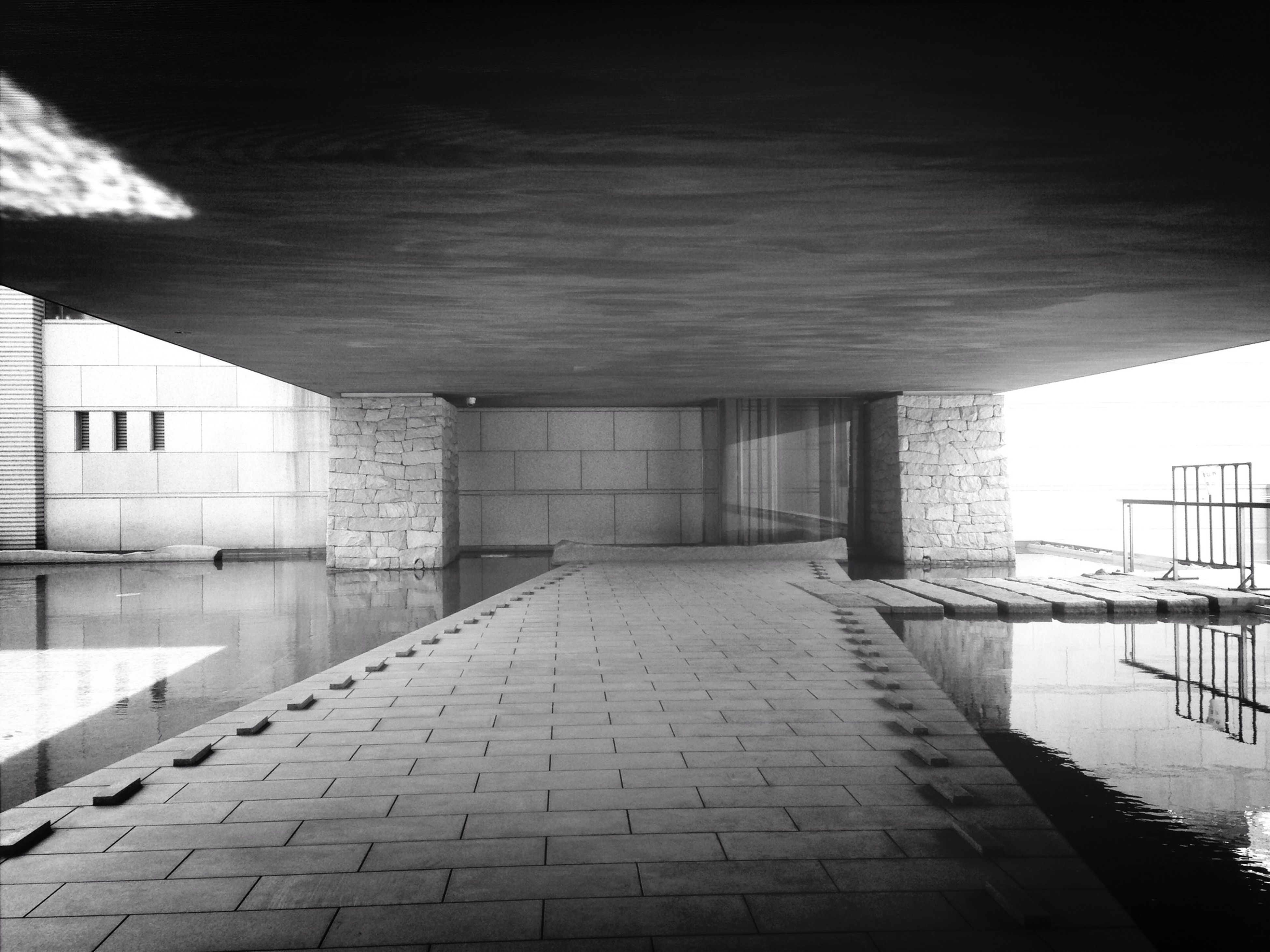 built structure, architecture, the way forward, water, diminishing perspective, building exterior, walkway, long, reflection, empty, narrow, vanishing point, no people, sky, sunlight, railing, indoors, building, ceiling, day