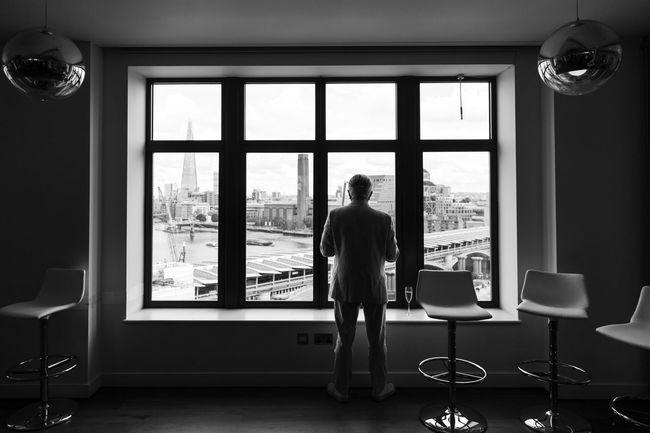 A man at the window Blackandwhite Blackfriars Bridge Greyman Londonview Lonliness Theshardlondon Thoughts Window View