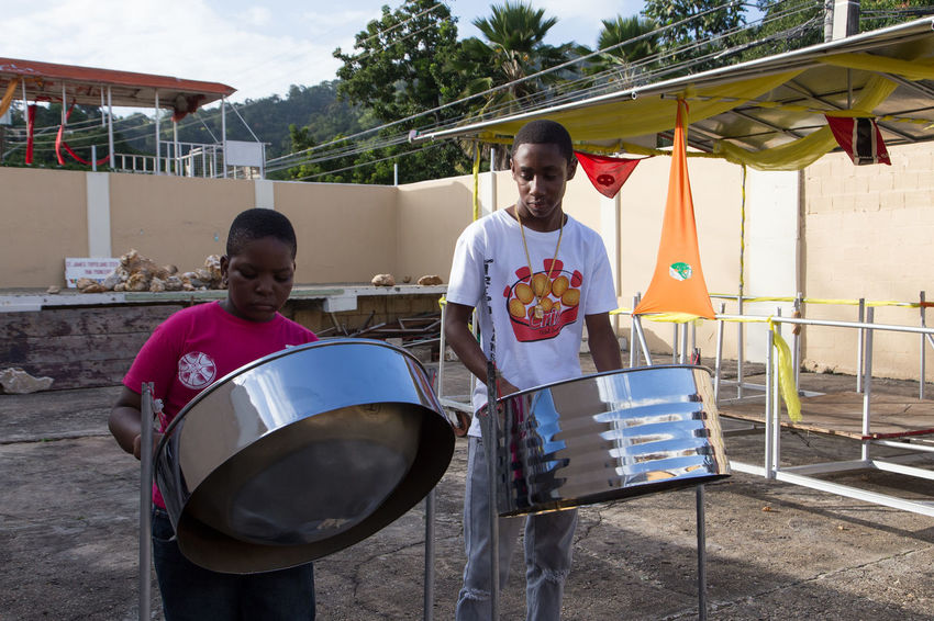 Music Port Of Spain , Trinidad Capital View Steel Drums Trinidad And Tobago Architecture Built Structure Day Drum - Percussion Instrument Drummer Leisure Activity Men Musical Instrument Outdoors Playing Port Of Spain Port Of Spain Trinidad Real People Sitting Togetherness Young Adult