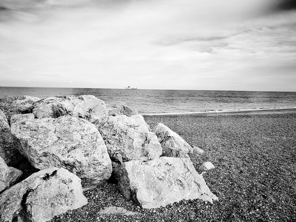 Rocks By The Ocean in B/W Sea Beach Horizon Over Water Sand Sky Water Nature Outdoors Cloud - Sky Day Tranquility No People Beauty In Nature Scenics Summer Views Summer Days By The Ocean Wave Summer Summertime Nature Blue Tranquil Scene Ocean And Sky The Great Outdoors - 2017 EyeEm Awards EyeEmNewHere