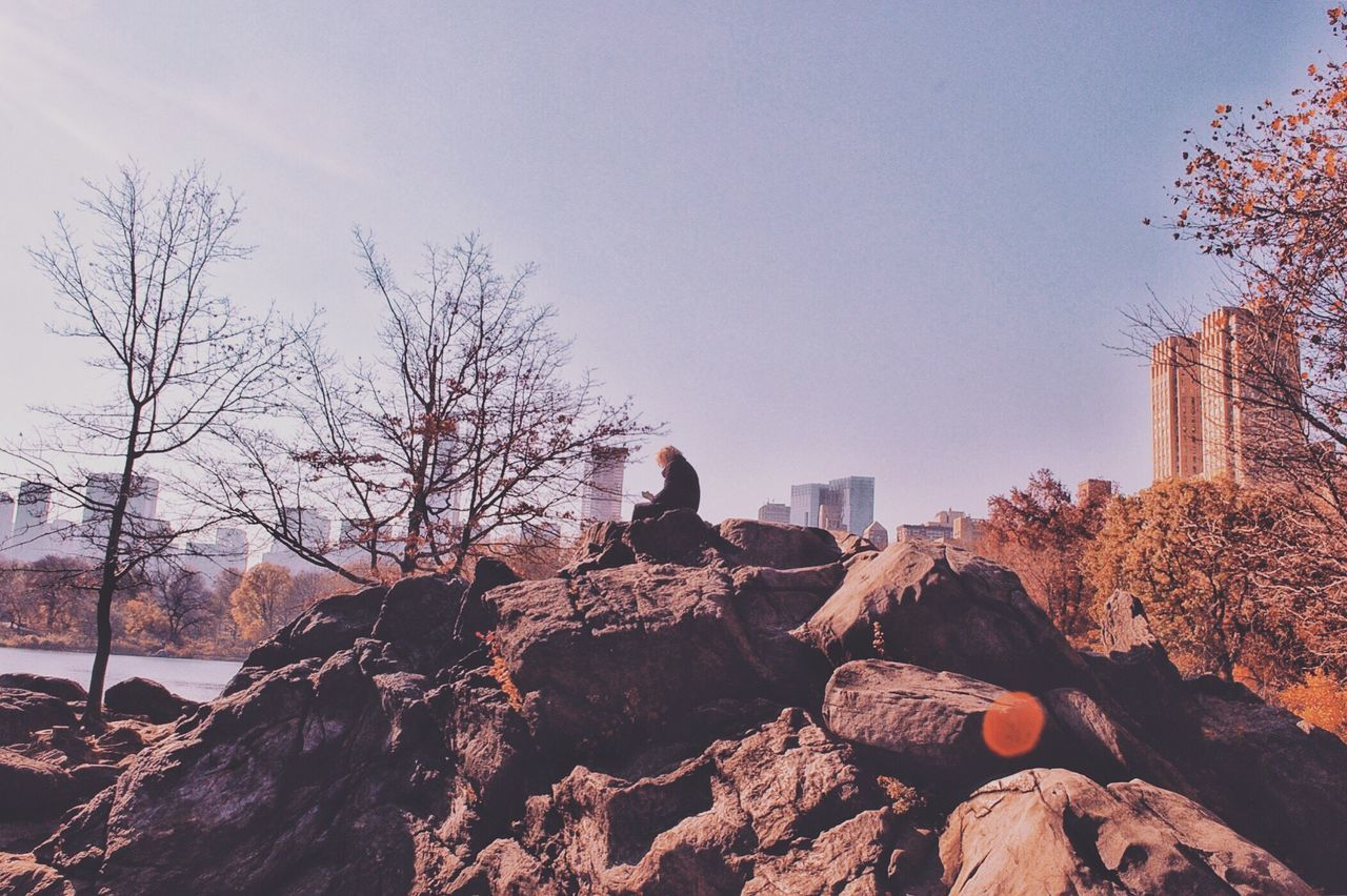Rock - Object Nature Bare Tree Real People Outdoors Day One Person Tree Leisure Activity Clear Sky Sitting Sky Beauty In Nature People The Street Photographer - 2017 EyeEm Awards The Great Outdoors - 2017 EyeEm Awards The Architect - 2017 EyeEm Awards