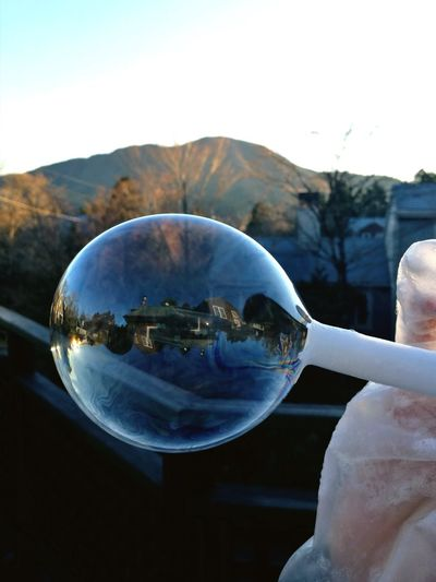 Soap bubble Soap Bubble Landscape Mountain Silhouette House One Person Only Women Outdoors Human Body Part Day Close-up Sky Nature