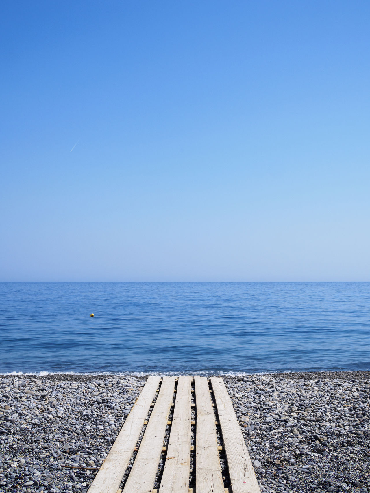 Sougia beach on the south side of Crete Beach Blue Holiday Horizon Over Water Minimalism No People Pebble Sea Sky Summer Tranquil Scene Tranquility Travel Destinations Vacations Walkway Water