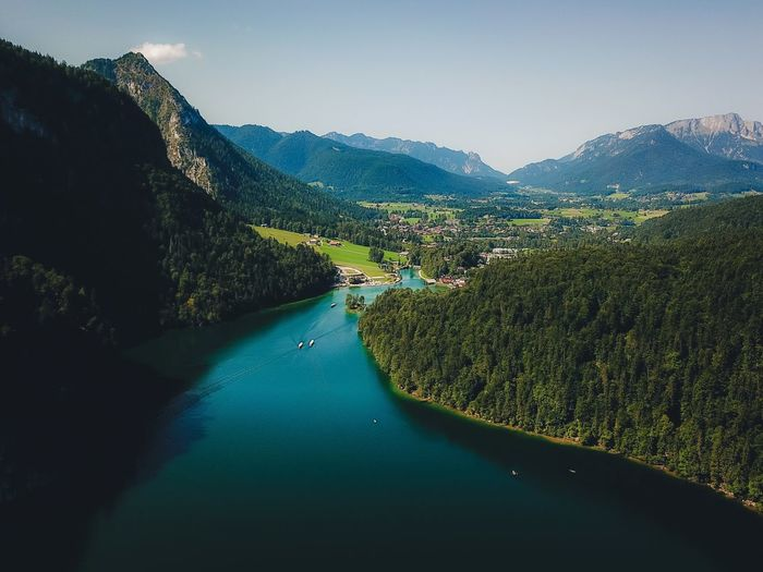 Mountain Scenics Nature High Angle View Beauty In Nature Tranquil Scene Mountain Range Water Tranquility River Transportation Outdoors Sky No People Day Nautical Vessel Landscape Tree Road Clear Sky Lost In The Landscape Connected By Travel Dronephotography Lake View Königssee Perspectives On Nature