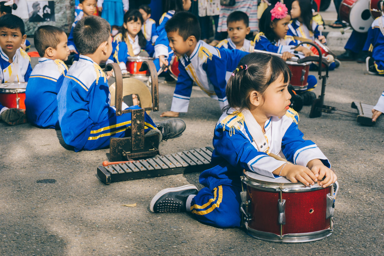 marching band Blue Boys Carnival Crowds And Details Child Childhood Children Only Crowd Day Education EyeEmNewHere Girls Instruments Kids Large Group Of People Marching Band Marching Band Instruments Outdoors People Sitting Street Street Photography Waiting