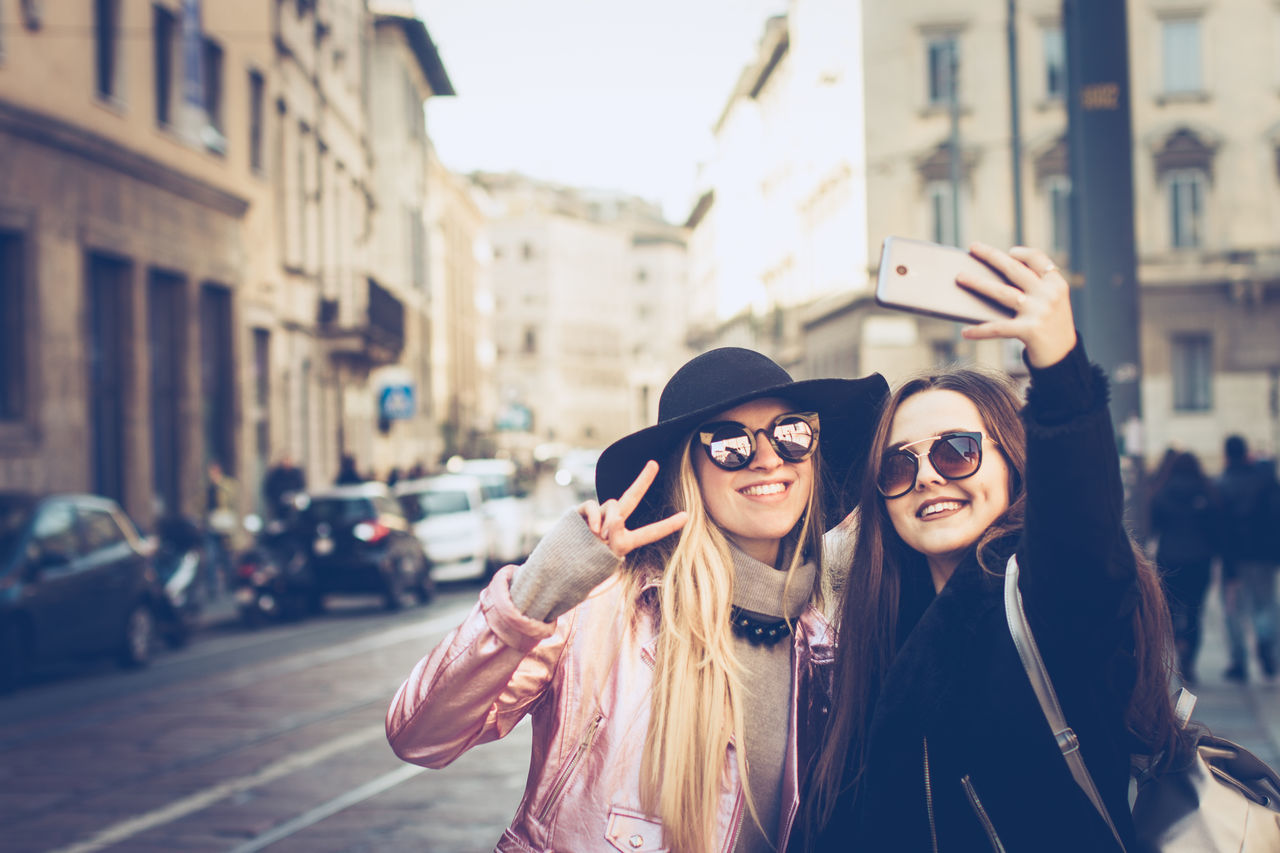 Best friends. Girls taking selfie, Milan, Italy. Adult Adults Only Beautiful People Beauty Cheerful City City Life Females Happiness Italy Lifestyles Milan People Portable Information Device Selfie Smart Phone Smiling Street Togetherness Tourist Travel Two People Women Young Adult Young Women