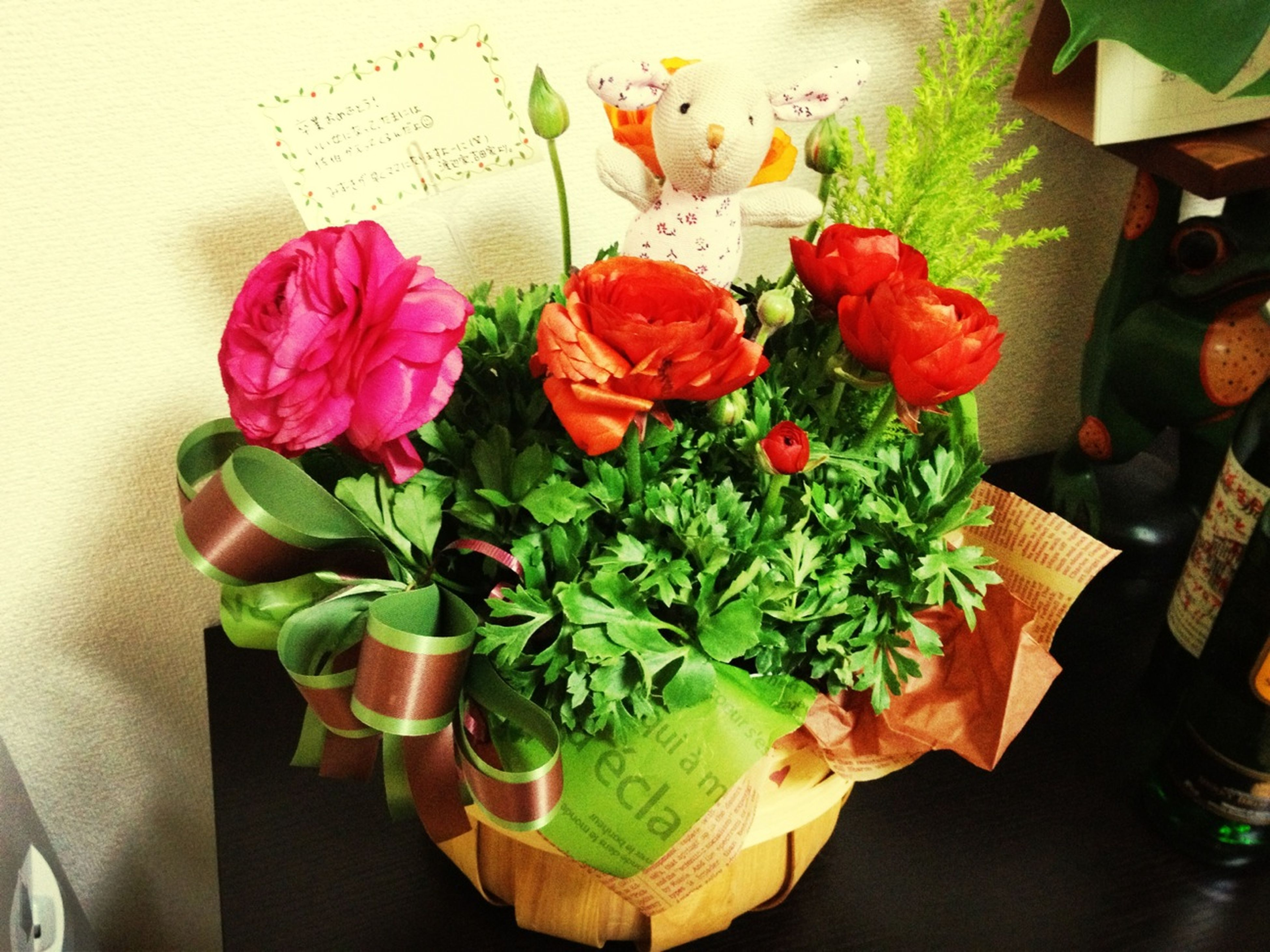 indoors, table, flower, still life, freshness, high angle view, variation, vase, close-up, arrangement, no people, fragility, petal, decoration, multi colored, paper, directly above, red, wood - material, flower arrangement