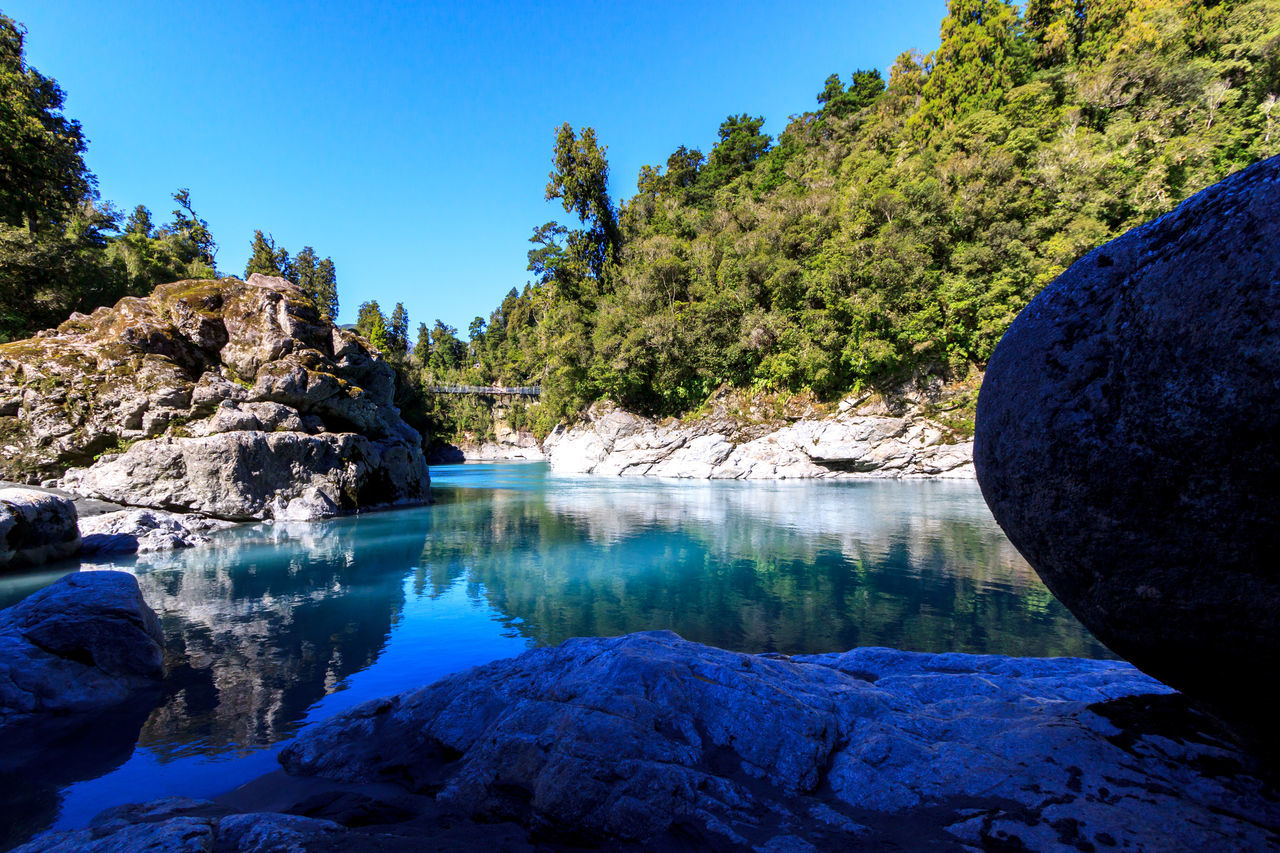 Hokitika Gorge, with bright blue water Beauty In Nature Blue Blue Water Clear Sky Day Eye4photography  EyeEm Nature Lover Mountain Nature No People Outdoors Physical Geography River Rock - Object Scenics Sky Tranquil Scene Tranquility Tree Water Waterfall