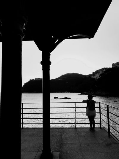 Railing One Person Standing Water Full Length Real People Sea Architecture Day Built Structure Clear Sky Nature Outdoors Sky Men People Black And White Friday An Eye For Travel