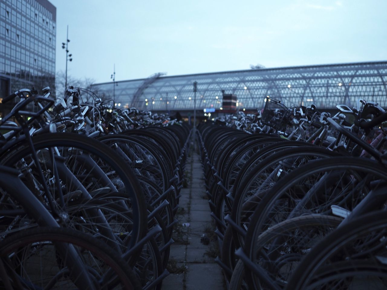 Bicycle Bicycle Rack Bike Bikes City Commuting Day In A Row No People Outdoors Parking Parking Lot Sky Train Station Transportation