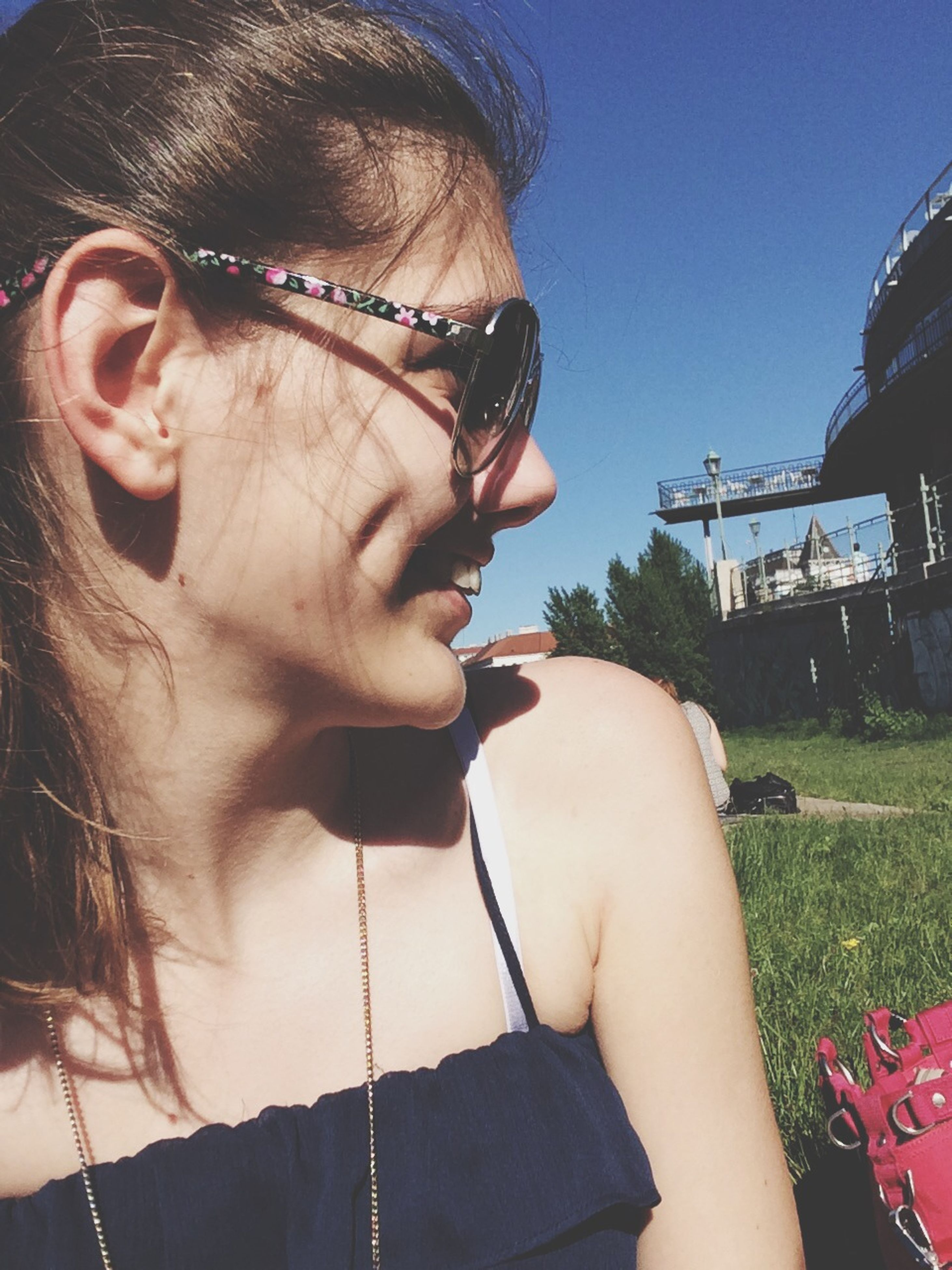 lifestyles, young adult, person, leisure activity, headshot, young women, holding, sunglasses, front view, casual clothing, close-up, focus on foreground, head and shoulders, portrait, looking at camera, smiling, human face
