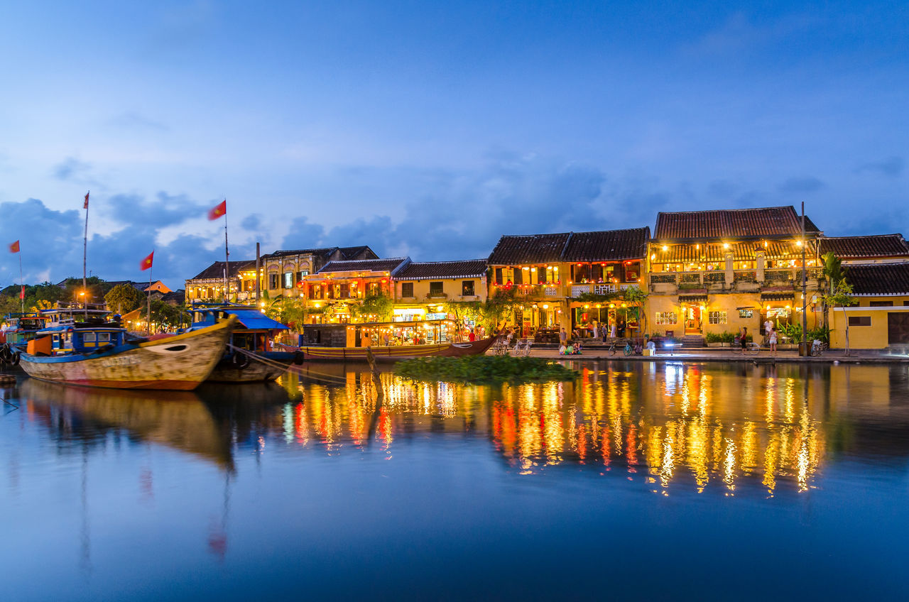Hoi An reflected in the river during sunset Architecture ASIA Blue Boat Boats Cloud - Sky Dawn Dusk Harbor Historical Building Hoi An Nautical Vessel Night Old Reflection Reflection River Riverside Sky Transportation UNESCO World Heritage Site Vietnam Vintage Water Waterfront