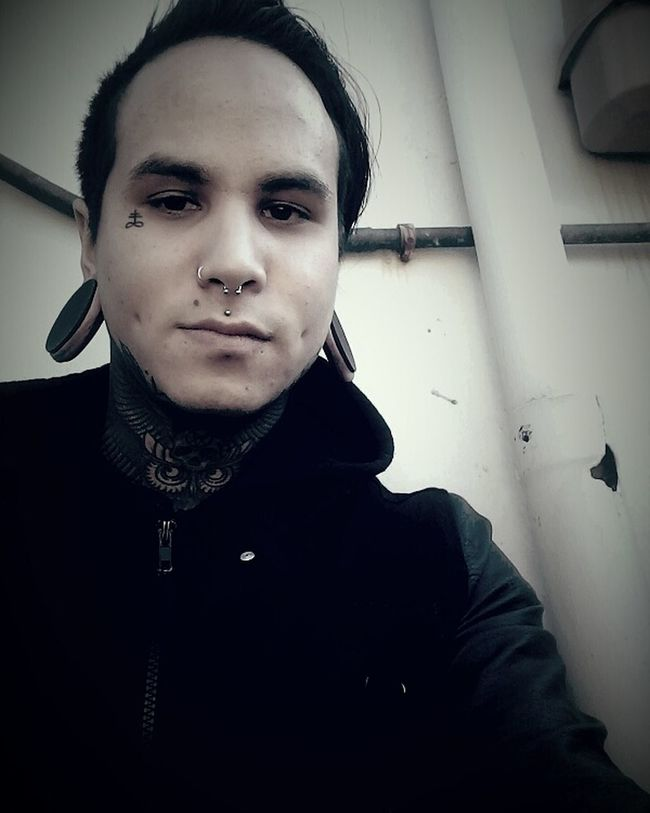 Guyswithtattoos Guyswithstretchedears Male Black Looking At Camera Portrait Front View Indoors  Person Young Adult Serious Confidence  Handsome Domestic Life