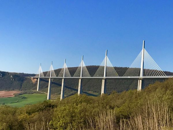 Architecture Bridge - Man Made Structure Built Structure Copy Space Outdoors Day Clear Sky Connection Blue No People River Nature Mountain Sky Grass Beauty In Nature Water Le pont de Millau