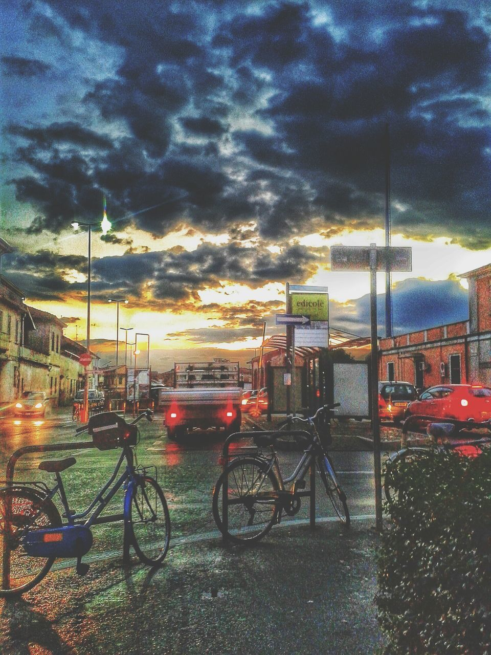 bicycle, transportation, land vehicle, mode of transport, sky, stationary, built structure, architecture, outdoors, no people, cloud - sky, building exterior, sunset, illuminated, nature, day, city