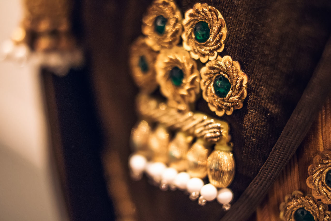 jewelry, indoors, no people, close-up, wood - material, elegance, gold colored, luxury, day