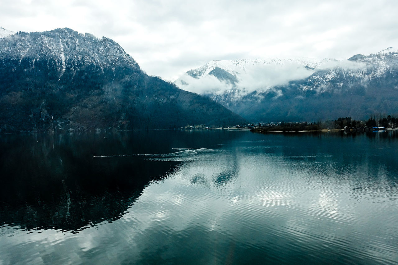 mountain, cold temperature, snow, beauty in nature, tranquil scene, water, scenics, lake, winter, reflection, tranquility, nature, mountain range, sky, idyllic, ice, waterfront, frozen, no people, outdoors, cloud - sky, snowcapped mountain, day, tree, iceberg