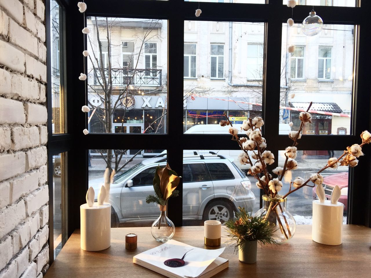 A view at the window of the restaurant which is decorated nicely Beautiful Bricks Candles City Life Cotton Cotton Flowers Day Design Indoors  Interior Design Kiev Magazine No People Restaurant Street Street Life Ukraine Vase Window