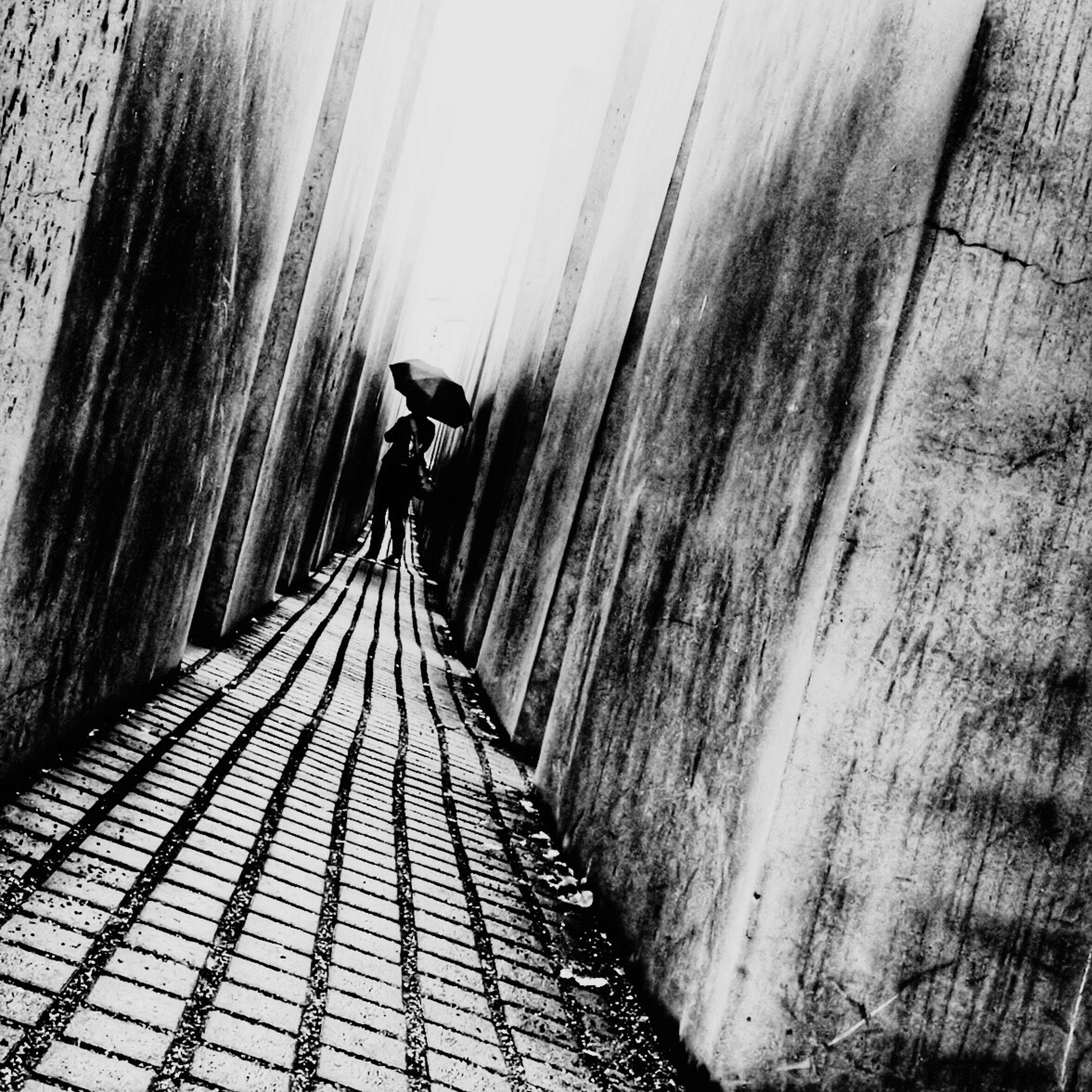 the way forward, walking, rear view, lifestyles, full length, men, diminishing perspective, leisure activity, vanishing point, person, architecture, built structure, standing, day, unrecognizable person, walkway, indoors