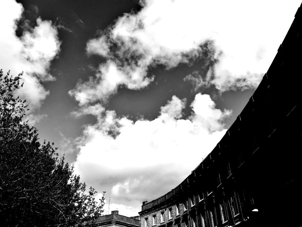 Sky Cloud - Sky Beauty In Nature No People Outdoors Tree Building Exterior City Light And Shadow Dramatic Sky Cloud Black And White Architecture Built Structure Shadow Blackandwhite Photography Black & White Huawei P9 Leica Huawei Photography City Street