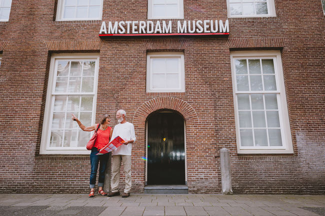 Amsterdam Architecture Brick Wall Building Exterior Built Structure Closed Door Entrance Exterior Historic History Lifestyles Men Museum Older Couple Real People Sitting Spirituality Standing The Tourist Tourism Urban Wall Window Women