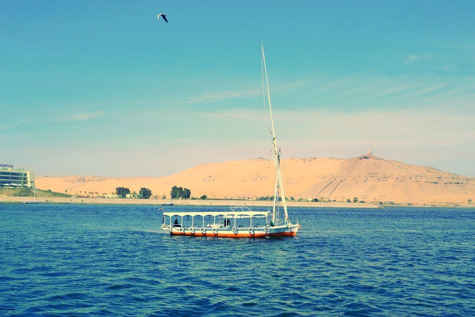 Nautical Vessel Transportation Sea Sailing Water Outdoors Sky Blue Day Business Finance And Industry Sailboat Clear Sky No People Sailing Ship Nature Yacht Yachting Oil Pump Beauty In Nature EyeEm Best Shots Tourism Multi Colored Photogtaphyinmotion Landscape Travel Destinations