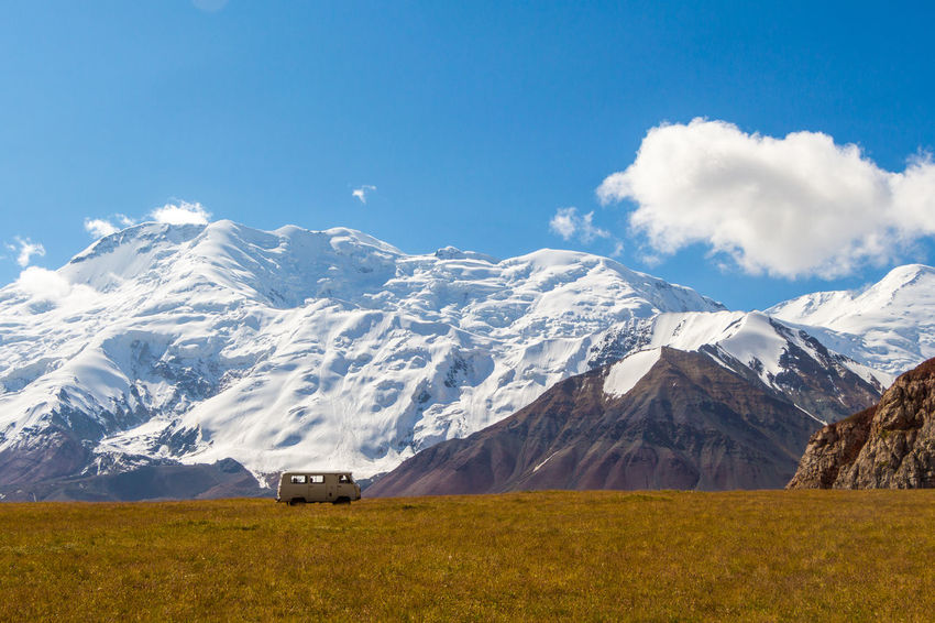 Kyrgyzstan Pamir Mountains Transportation Beauty In Nature Blue Cloud - Sky Cold Temperature Day Landscape Mountain Mountain Range Nature No People Outdoors Pamir Scenics Sky Snow Snowcapped Mountain Tranquil Scene Tranquility
