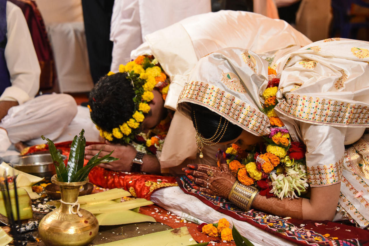 Weddings are important because they celebrate life and possibility - ✍️Anne Hathaway✍️ Bride amd groom taking blessings of gods and elders.😇 Celebration Wedding Ceremony Indoors  Floral Garland Cultures Traditional Ceremony Ceremony Togetherness Wedding Photography Indian Wedding Traditional Wedding Bridegroom Traditional Festival Celebration Sari Wedding Dress Wedding Bride Young Adult Traditional Clothing Two People Traditional Culture Engagement Bangle Religion