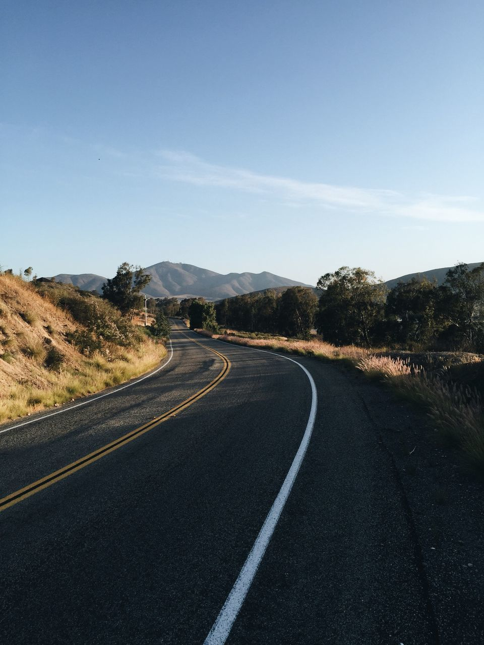 Empty Road Leading Towards Mountain