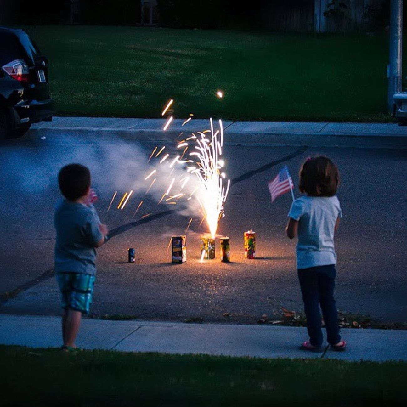 Kids being Patriotic . Fireworks 4thofjuly Holiday Love Instagood Love Dusk Night Dark Pyrotechnic Children Flag USA
