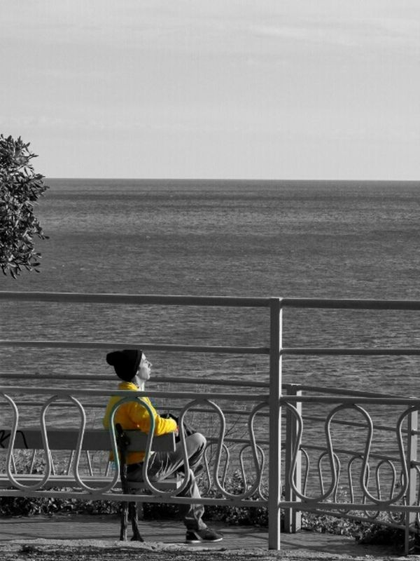 Enjoying the Sun Wanderlust colorsplash streetphoto_bw bw_collection eye4black&white  Relaxing sea by Simodenegri