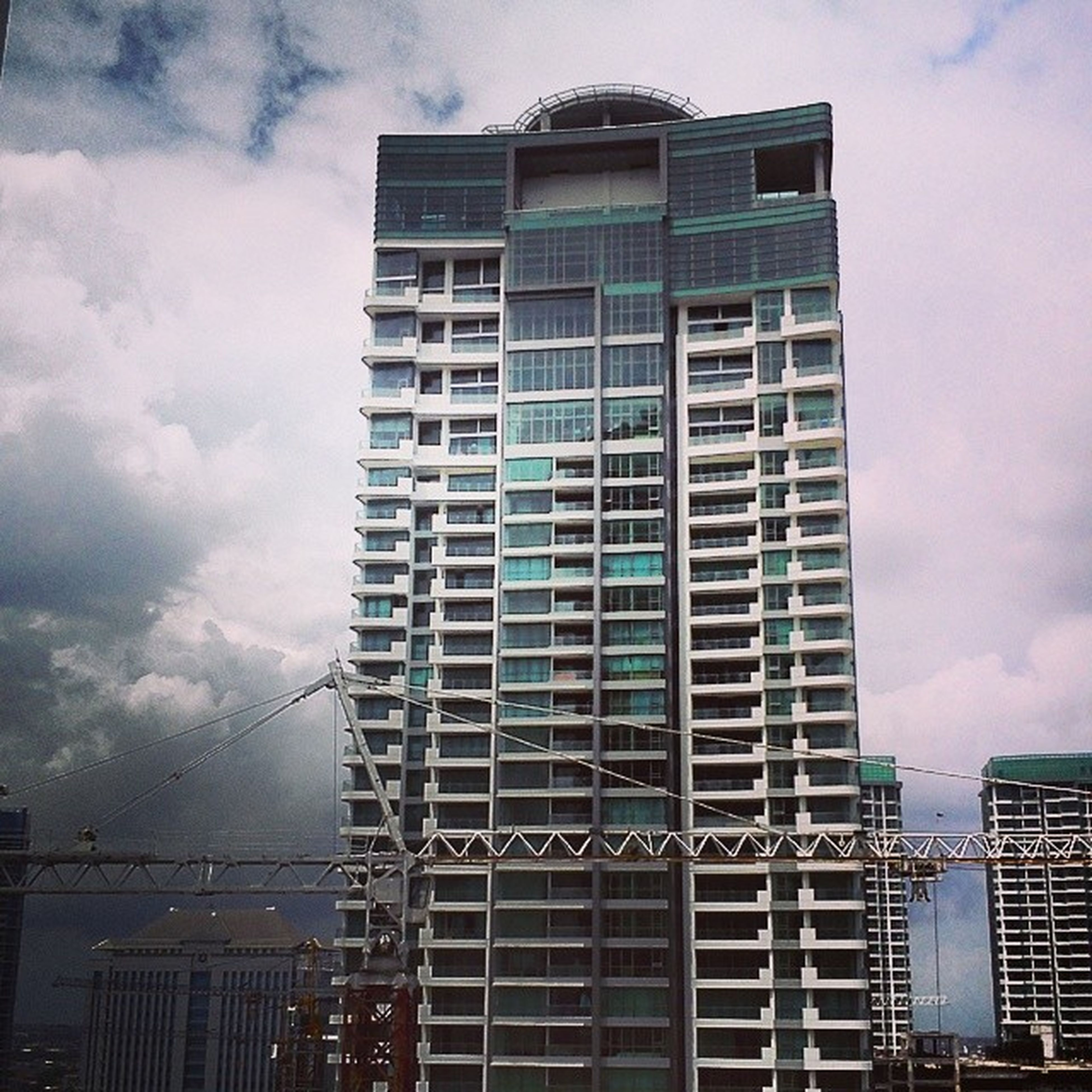 building exterior, architecture, built structure, sky, city, low angle view, modern, office building, cloud - sky, skyscraper, tall - high, building, cloudy, tower, cloud, glass - material, development, reflection, residential building, tall