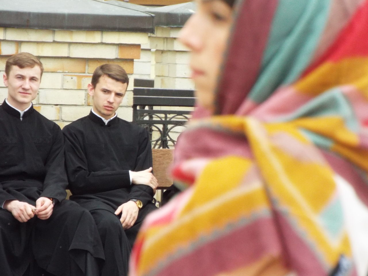 Practicing vicars sat on a bench in Kiev, Ukraine. A women came into shop, as I was capturing the image. Day Eastern Europe Kiev Kiev Ukraine Photojournalism Religion Sat Down The Photojournalist - 2016 EyeEm Awards The Street Photographer - 2016 EyeEm Awards Ukraine