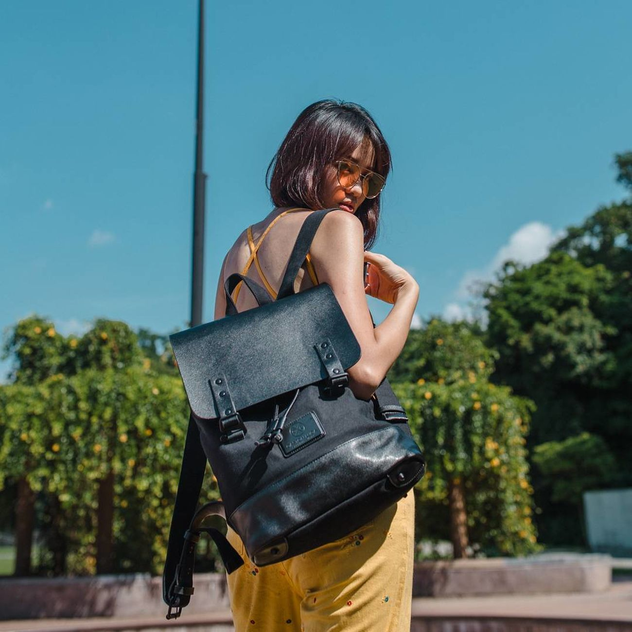 """This backpack from Gaston Luga is my new work bag because it looks so good and it can fit my 15"""" Macbook Pro (such a dealbreaker heh). They come with free shipping + 20% off as tax rebate (to NON-EU countries) + an additional 15% off the remainder if you use my code """"audreyk15""""! Check it out at www.gastonluga.com 🙌🏻🙌🏻 One Woman Only Women Outdoors Clean Portrait Of A Woman Portrait Photography Women Around The World Beautiful People Portrait Light Collection Light Blue Blue Sky Sunglasses Beautiful Girl Midday Tank Top Yellow Colorful Colorsplash Color Explosion Summer Babe Backpacking"""