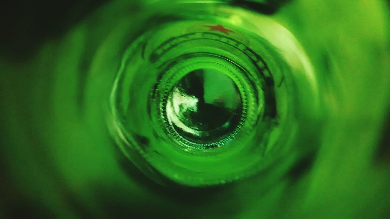Experience. Green Color Full Frame Close-up Beer Glass - Material Colorgreen Bottle Bottom Of The Glass Heineken Beer Concentric No People Backgrounds Nature Outdoors Day Water Freshness