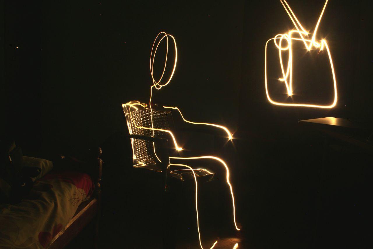 Old man watchin' the tele. No People Night Illuminated Black Background Indoors  Eyeem Market Objects Of Interest EyeEm Gallery EyeEm Best Shots EyeEm Masterclass EyeEmGalley Tranquility Light light and reflection Lightpainting Light Painting Photography. Close-up EyeEmNewHere