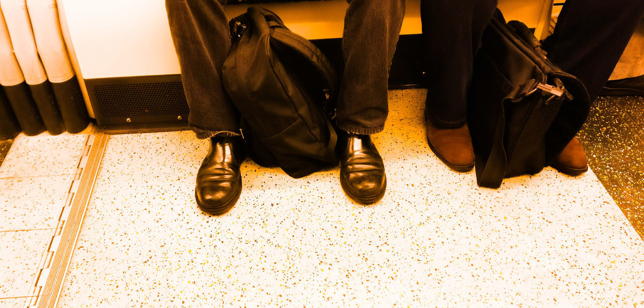 The Commute Low Section Lifestyles Human Leg People Human Body Part Adult Men Close-up Only Men Street Photography EyeEmNewHere Best EyeEm Shot Travel Transportation Train Tube Work Travel To Work Two People London London Lifestyle Travel Time Business Finance And Industry Businessman